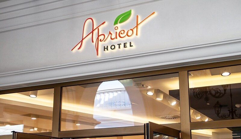hotel logo design apricot mock up